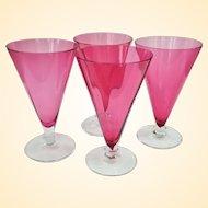 An Elegant Set Of Four Steuben Cranberry Glass Parfait Stems