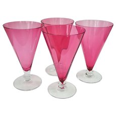An Elegant Set Of Four Steuben Cranberry Glass Parfait Stems