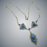 Vintage early silver tone baroque style pendant Necklace with mottled blue glass stones