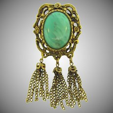 Vintage gold tone Brooch with art glass cabochon and chain dangles