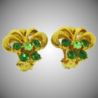 Signed Lisner clip back Earrings with green rhinestones