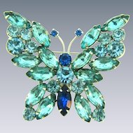 Vintage large figural butterfly Brooch with blue tone rhinestones