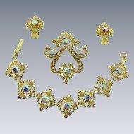 Gorgeous vintage parure of Bracelet, Brooch, clip back Earrings with red AB rhinestones