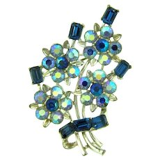 Signed Lisner floral Brooch with blue rhinestones