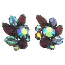Vintage 1960's rhinestone clip back Earrings with red and pink stones and iridescent molded glass leaves