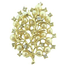 Signed Pegasus Coro floral Brooch with imitation pearls and crystal rhinestones