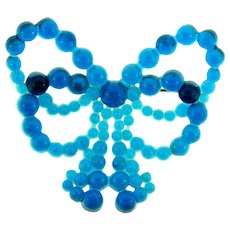 Vintage early plastic translucent beaded blue bow Brooch
