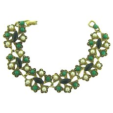 Signed Weiss link Bracelet with Lucite green beads, emerald green rhinestones and imitation pearls