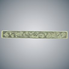 Marked sterling silver Bar Pin with chased floral design