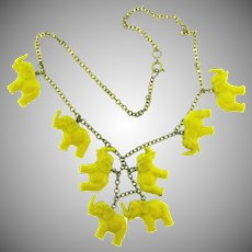 Vintage choker Necklace with celluloid figural yellow elephants