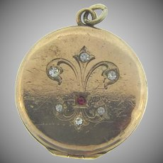 Vintage gold filled early Locket with chased fleur de lis and paste stones