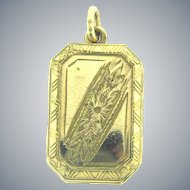 Vintage gold tone Locket with chase design