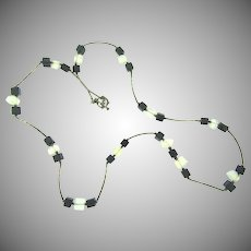 Vintage long Necklace with black glass cubes and opalescent glass pieces