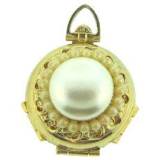 Signed Pegasus pat date to 1950's flip out locket with imitation pearls front