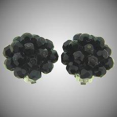 Signed Laguna black faceted glass bead clip back Earrings