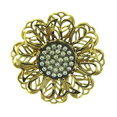 Vintage gold tone flower Brooch with center cluster of small crystal rhinestones