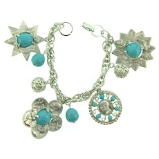 Signed Coro silver tone charm Bracelet with composition turquoise beads