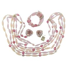 Signed Hobe parure of Necklace, memory wire Bracelet and clip back Earrings in pink shades