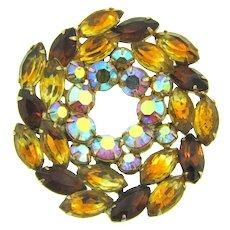 Vintage large pinwheel circular brooch with rhinestones in fall shades