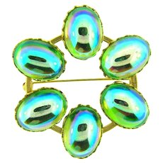 Vintage circular 1960's Brooch with green AB glass cabochons