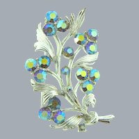 Signed Lisner silver tone floral Brooch with blue AB rhinestones