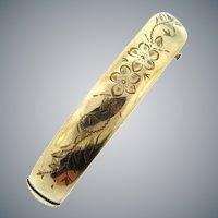 Marked 1/20 14kt H.F.B. gold filled tubular Bracelet with floral design