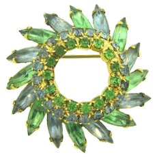 Vintage open center rhinestone pinwheel Brooch in pastel blue and green colors