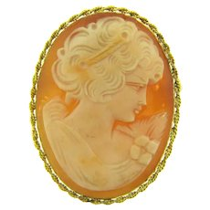 Vintage thin shell Cameo in gold tone rope frame