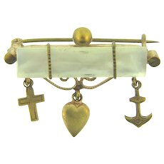 Vintage early Mother of Pearl Bar Pin with dangling cross, heart and anchor charms