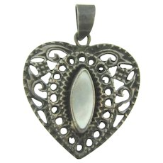 Marked 925 heart shaped Pendant with Mother of Pearl insert