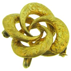 Early rolled gold lover's knot Watch Pin with reposse floral design