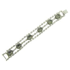 Vintage three strand silver tone Bracelet with crystal and smoky rhinestones