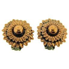 Signed Renoir copper floral design clip back Earrings