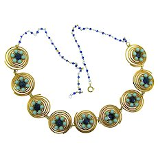 Unusual vintage link Necklace of gold tone coils with light blue beads and blue rhinestones