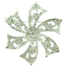 Vintage silver tone pinwheel Brooch with crystal rhinestones