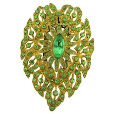 Vintage gilded pot metal Dress Clip with green rhinestones