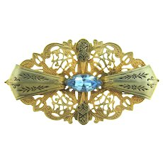Vintage gold tone lacy Brooch with blue rhinestone