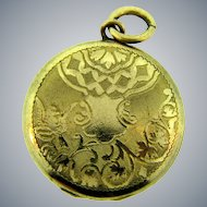 Signed L.B. small gold filled Locket with chased design and initials GLW