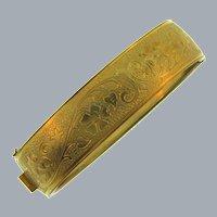 Vintage hinged bangle Bracelet with a repousse floral design
