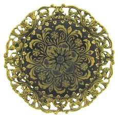 Vintage filigree frame Brooch with gilded design black glass medallion