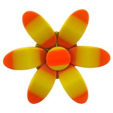 Vintage 1960's plastic flower Brooch with yellow and orange petals
