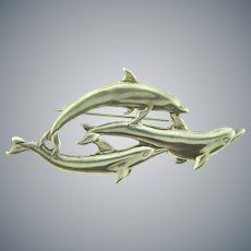 Marked sterling figural dolphins Brooch