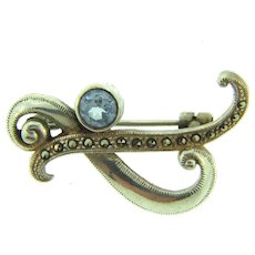 Marked 925 sterling silver Brooch with marcasites and aquamarine stone