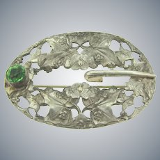 Vintage sash pin with floral Art Nouveau design and green glass stone