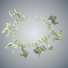 Marked sterling silver Charm Bracelet with eight sterling silver animal charms