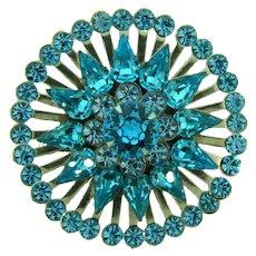 Vintage circular silver tone Brooch with blue rhinestones