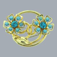 Signed Coro floral circular Brooch with blue rhinestones