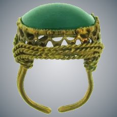 Marked made in Austria vintage gold tone adjustable Ring with green glass stone
