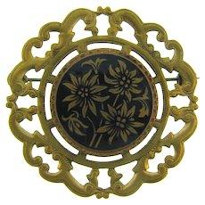 Vintage large circular edelweiss flower Brooch with black enamel design