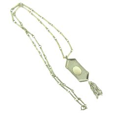 Signed Celebrity N.Y. long light gold tone Necklace with tasseled mesh pendant